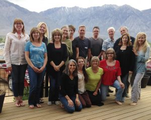 Group photo of participants in Theta healing workshop in front of mountain range - The Flow of Healing.com