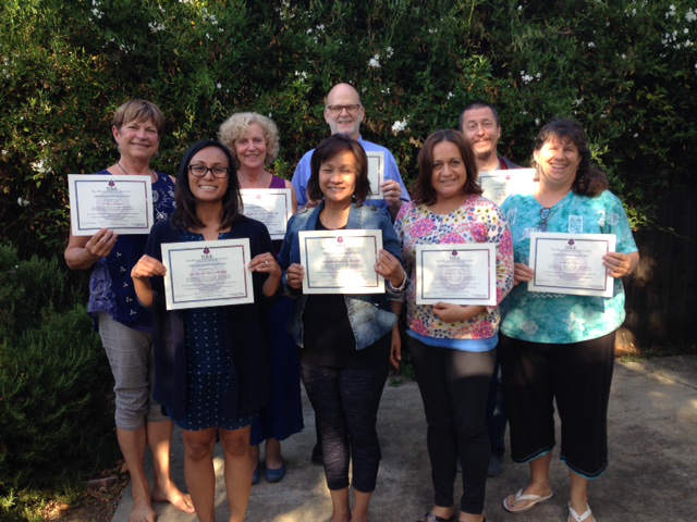Group photo of participants in Theta healing workshop with certificates of completion - The Flow of Healing.com