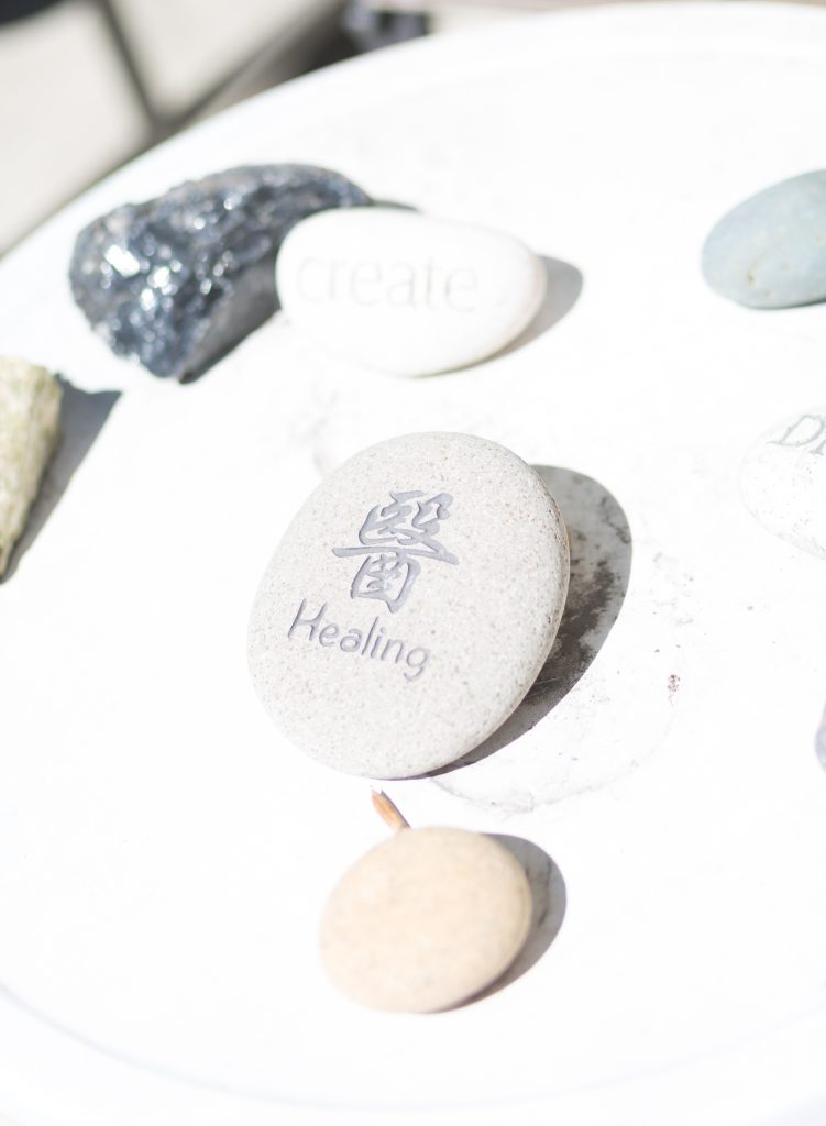 photos of healing stones with chinese script engraved - The Flow of Healing.com